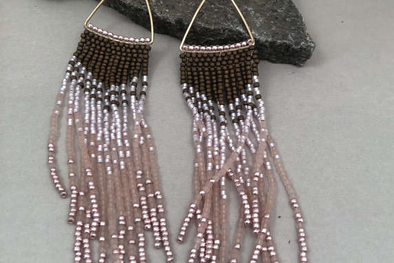 Long bronze and pink fringe earrings on gold