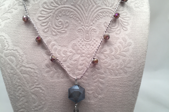 Plum and gray crochet necklace with leather tassle