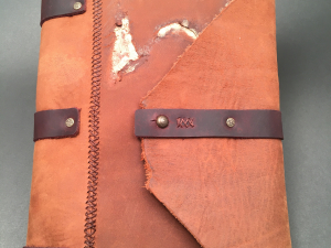 light and dark brown leather hand stitched journal with button closure